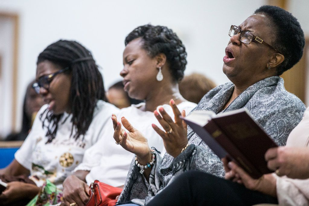 Allison Jean, mother of Botham Shem Jean, sings during a prayer vigil for her son at the Dallas West Church of Christ on Saturday, Sept. 8 in Dallas. He was shot by a Dallas police officer in his apartment on Thursday night.
