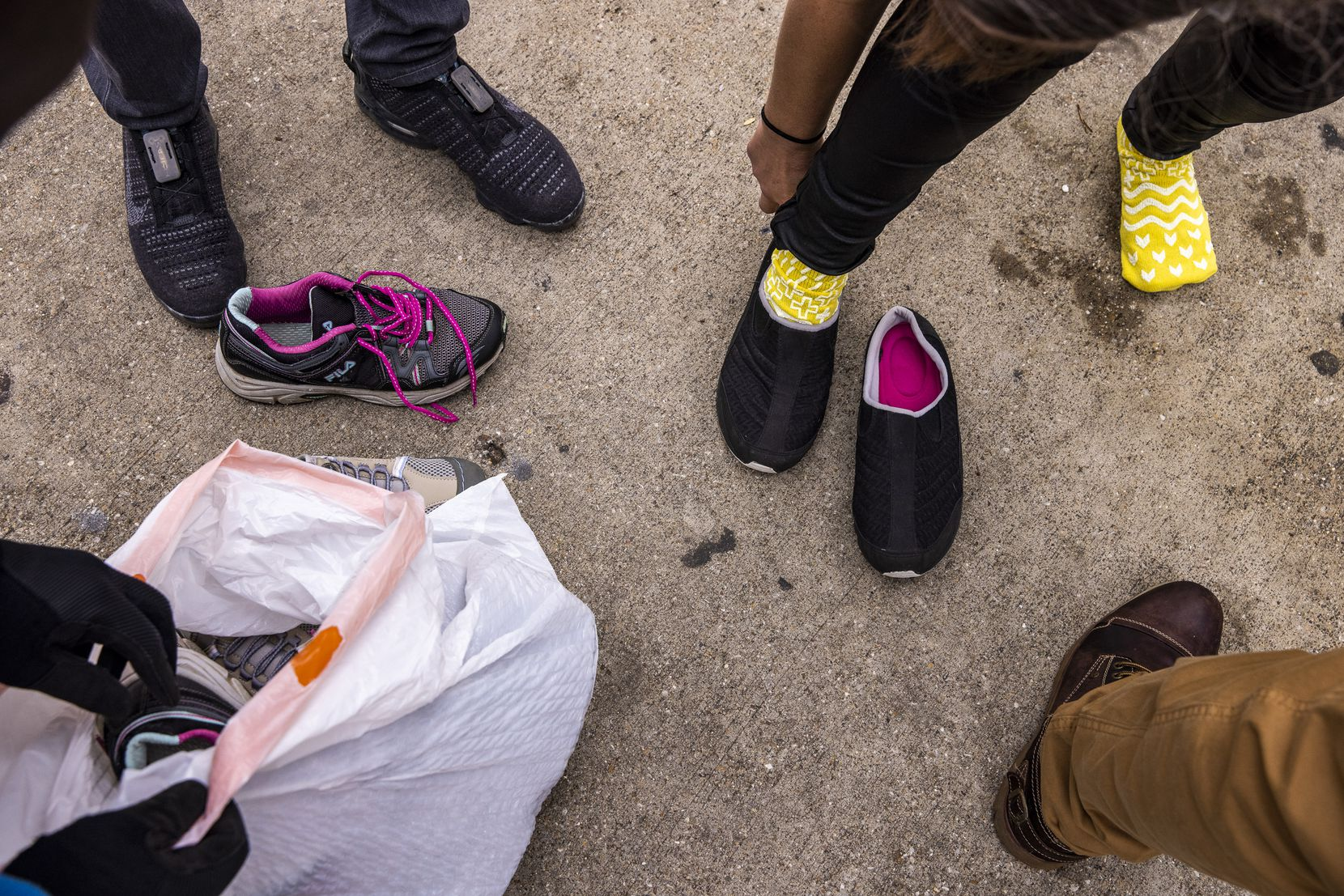 The Downtown Dallas, Inc. homeless outreach team provided shoes to an unhoused woman, whose only footwear was a pair of hospital-issued socks. The team, which works six days a week in downtown Dallas, then took the woman to OurCalling, where they could assess her needs.