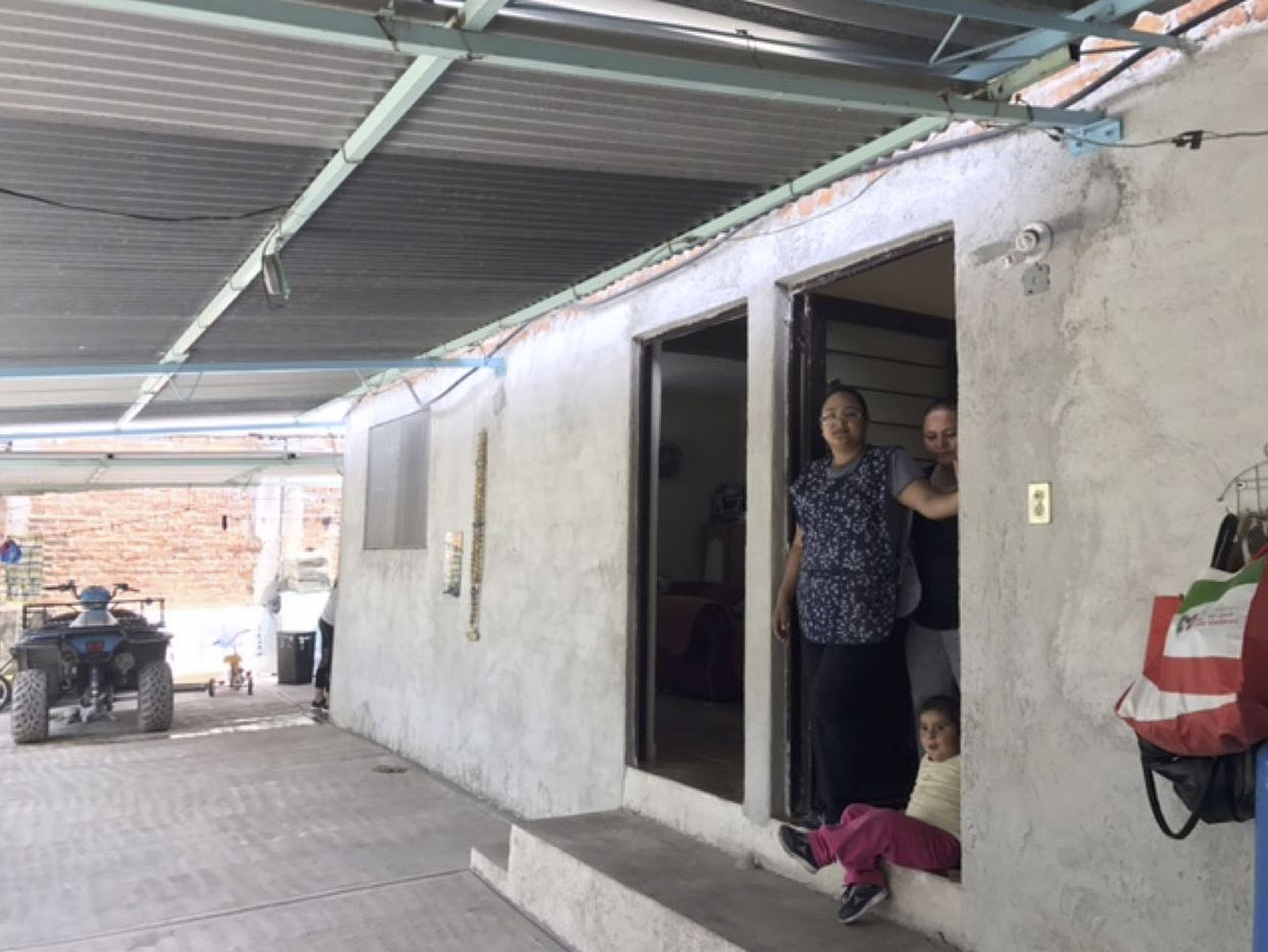 The Lopez sisters, Yanet and Margarita, show their family patio, which is being turned into an extra seating area for their restaurant under expansion.