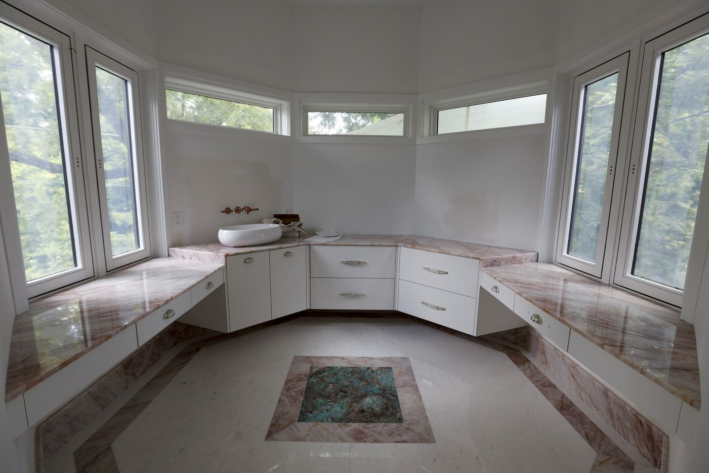 There's an octagonal vanity room in the master bathroom.