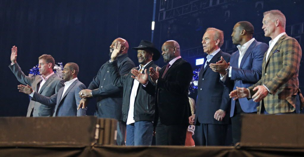 """Former Cowboys players are introduced at the United Way fundraiser event at AT&T Stadium in Arlington on Friday, February 6, 2015. Left to right are Troy Aikman, Tony Dorsett, Ed """"TooT all"""" Jones, Preston Pearson, Emmitt Smith, Roger Staubach, Darren Woodson and Daryl Johnston.  (Louis DeLuca/The Dallas Morning News)"""