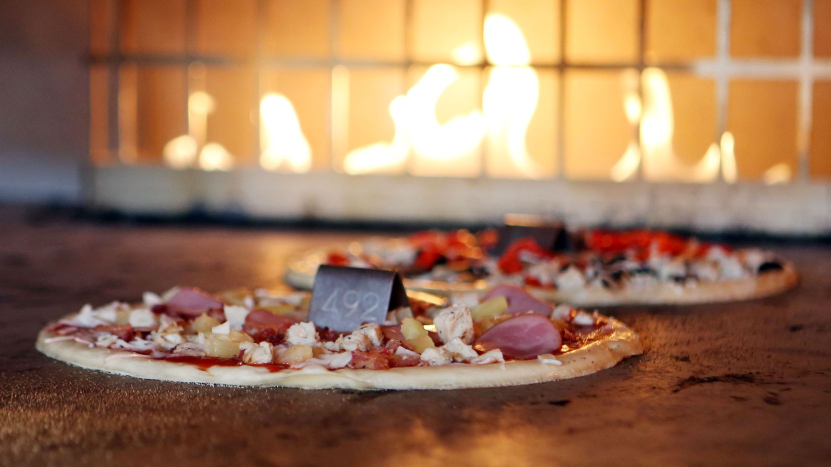 Blaze Pizza uses a hot open-flame oven to cook thin crust pizzas.