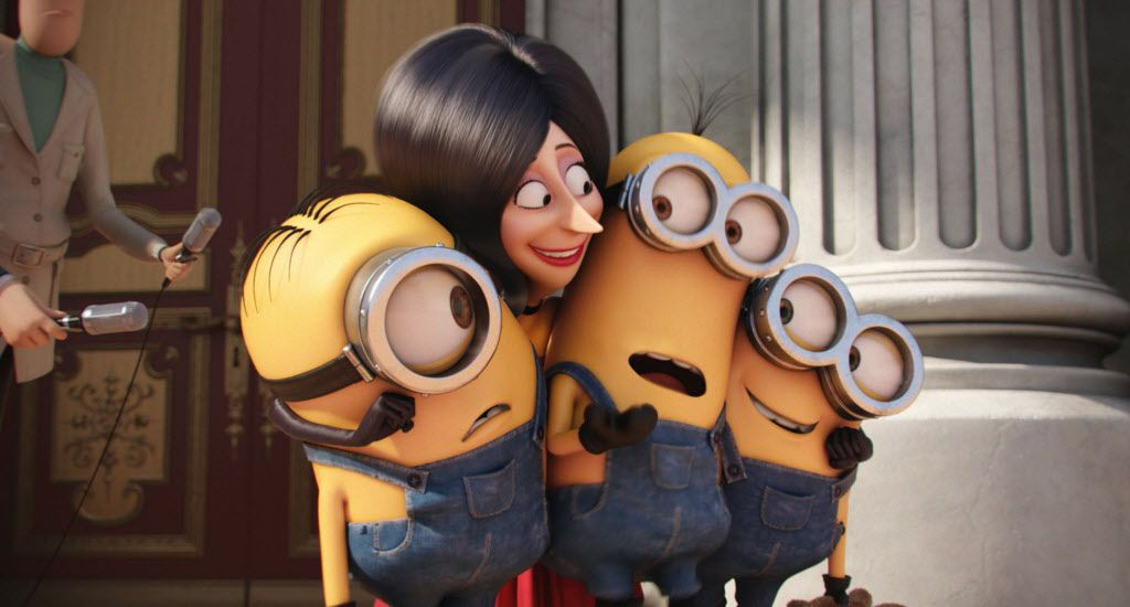 In this image released by Universal Pictures, Scarlet Overkill, voiced by Sandra Bullock, second left, appears with minions Stuart, left, Kevin and Bob, right, in a scene from the animated feature, Minions.