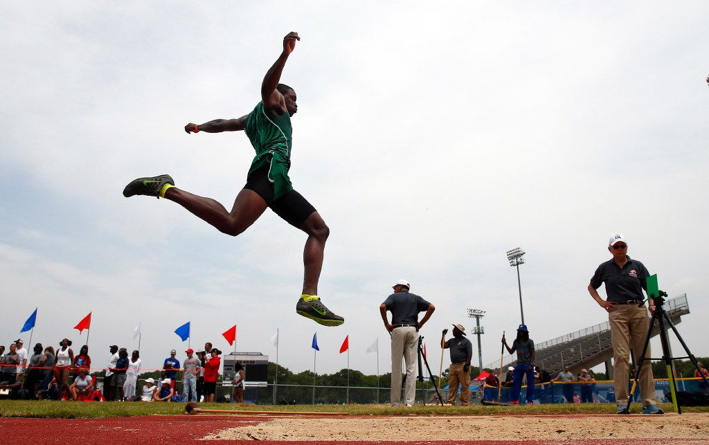 Waxahachie long jumper Jalen Reagor competes in the preliminary round of the 5A Region II meet at Maverick Stadium in Arlington, Texas, Friday, April 28, 2017. Reagor who's father played 9 season in the NFL, is committed to play football at TCU. (Tom Fox/The Dallas Morning News)