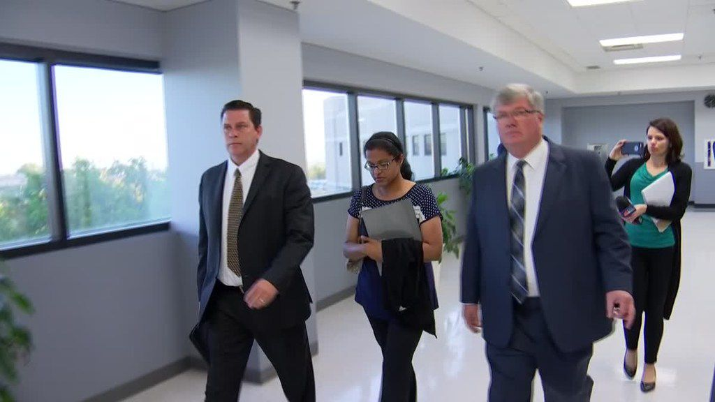 Sini Mathews leaves a court appearance Monday where she learned that her biological child, a 4-year-old girl, will remain in foster care for another three weeks while Wesley Mathews looks for a civil attorney.