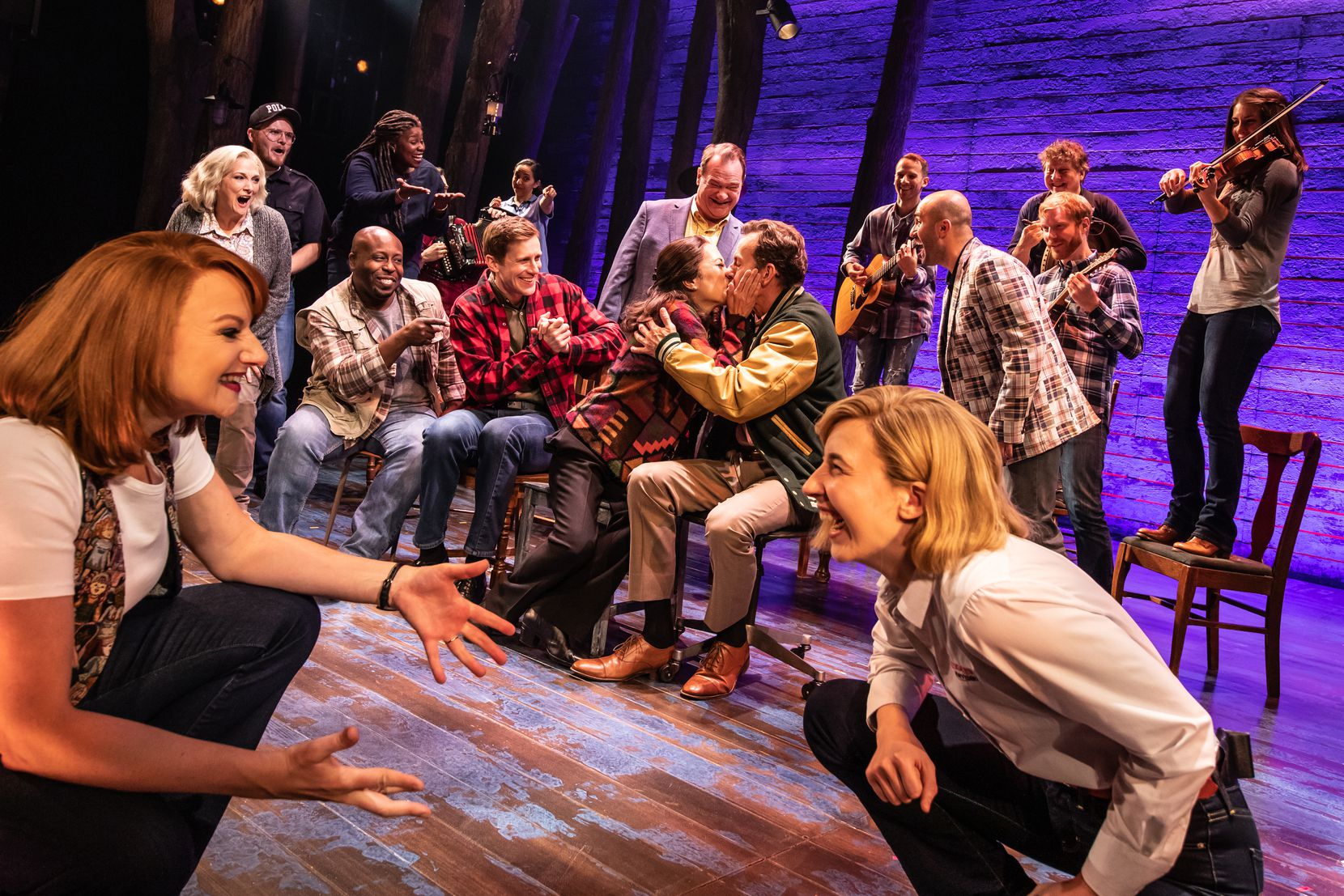 "Chamblee Ferguson as English oil engineer Nick Marson kisses his bride-to-be in the touring Broadway musical ""Come From Away."""