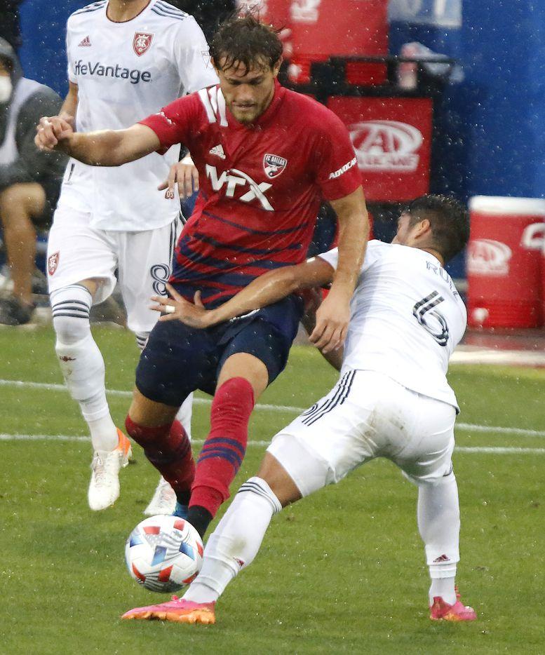 FC Dallas midfielder Tanner Tessmann (15) is hit by Real Salt Lake midfielder Pablo Ruiz (6) during the first half as FC Dallas hosted Real Salt Lake at Toyota Stadium in Frisco on Saturday, May 22, 2021. (Stewart F. House/Special Contributor)