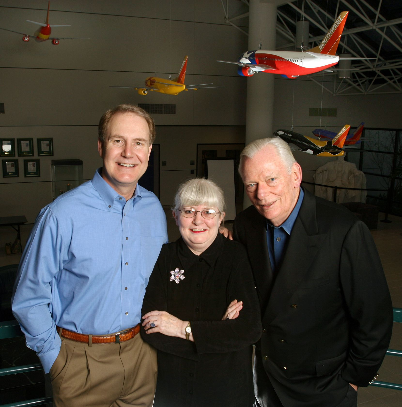 From left: In 2008, Southwest Airlines' Gary Kelly posed in the lobby of the company's headquarters in Dallas with then-president Colleen Barrett and chairman Herb Kelleher. Kelleher died in 2019.