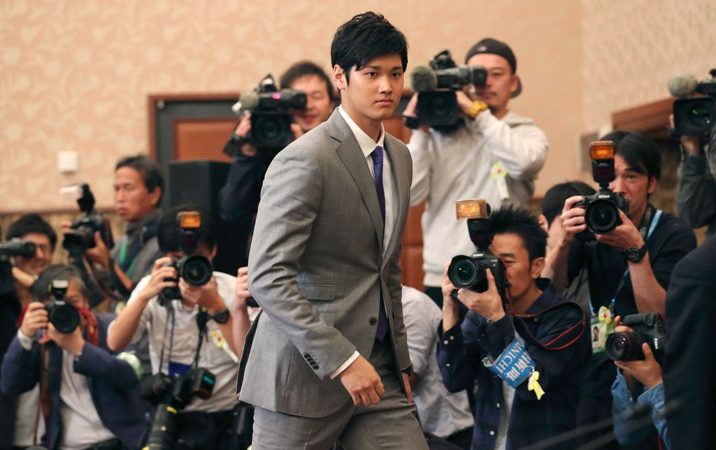 Japanese pitcher-outfielder Shohei Ohtani arrives for a press conference at Japanese National Press Center in Tokyo, Saturday, Nov. 11, 2017.  Ohtani announced on Saturday he wants to move to Major League Baseball next season. (AP Photo/Koji Sasahara)
