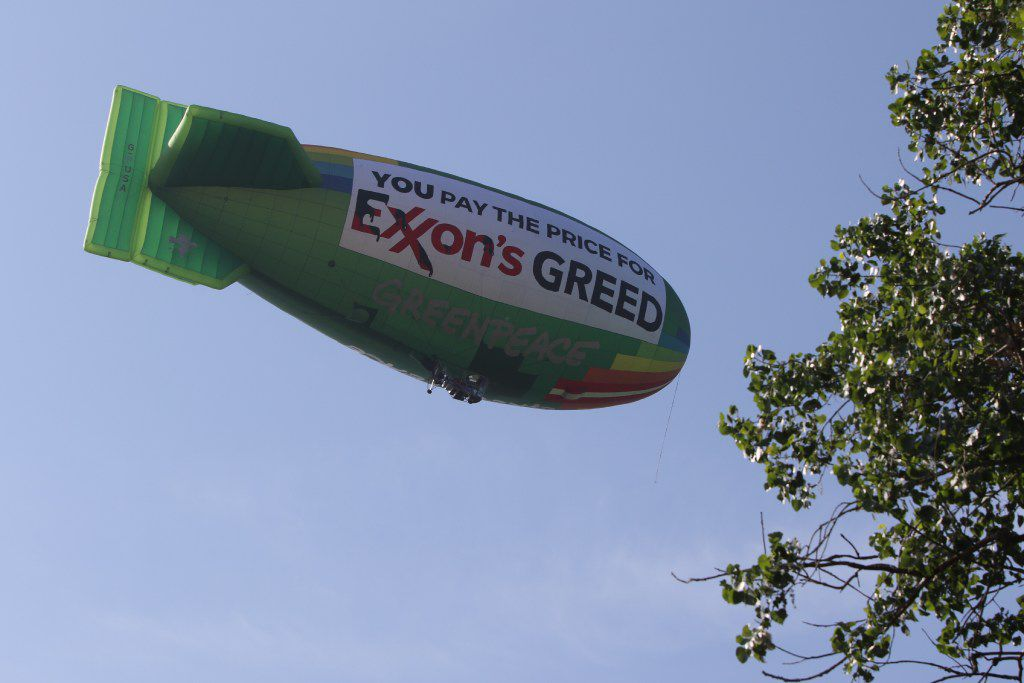 A Greenpeace blimp, protesting Exxon, headed back to Dallas Executive Airport after flying over Dallas as Exxon's annual shareholders met at the Meyerson Symphony Center.