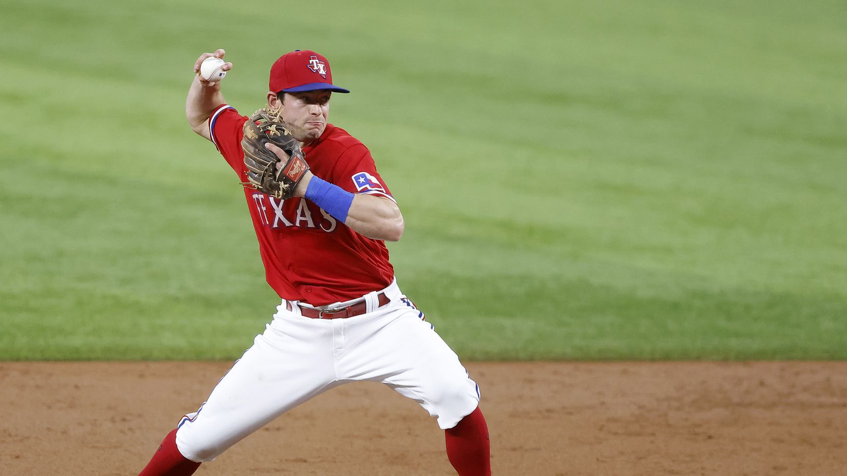 Texas Rangers second baseman Nick Solak (15) turns the front end of a double play attempt against the Houston Astros in the second inning at Globe Life Field in Arlington, Texas, Friday, May 21, 2009. Houston Astros batter Yuli Gurriel was out at second and Yordan Alvarez scored form third.