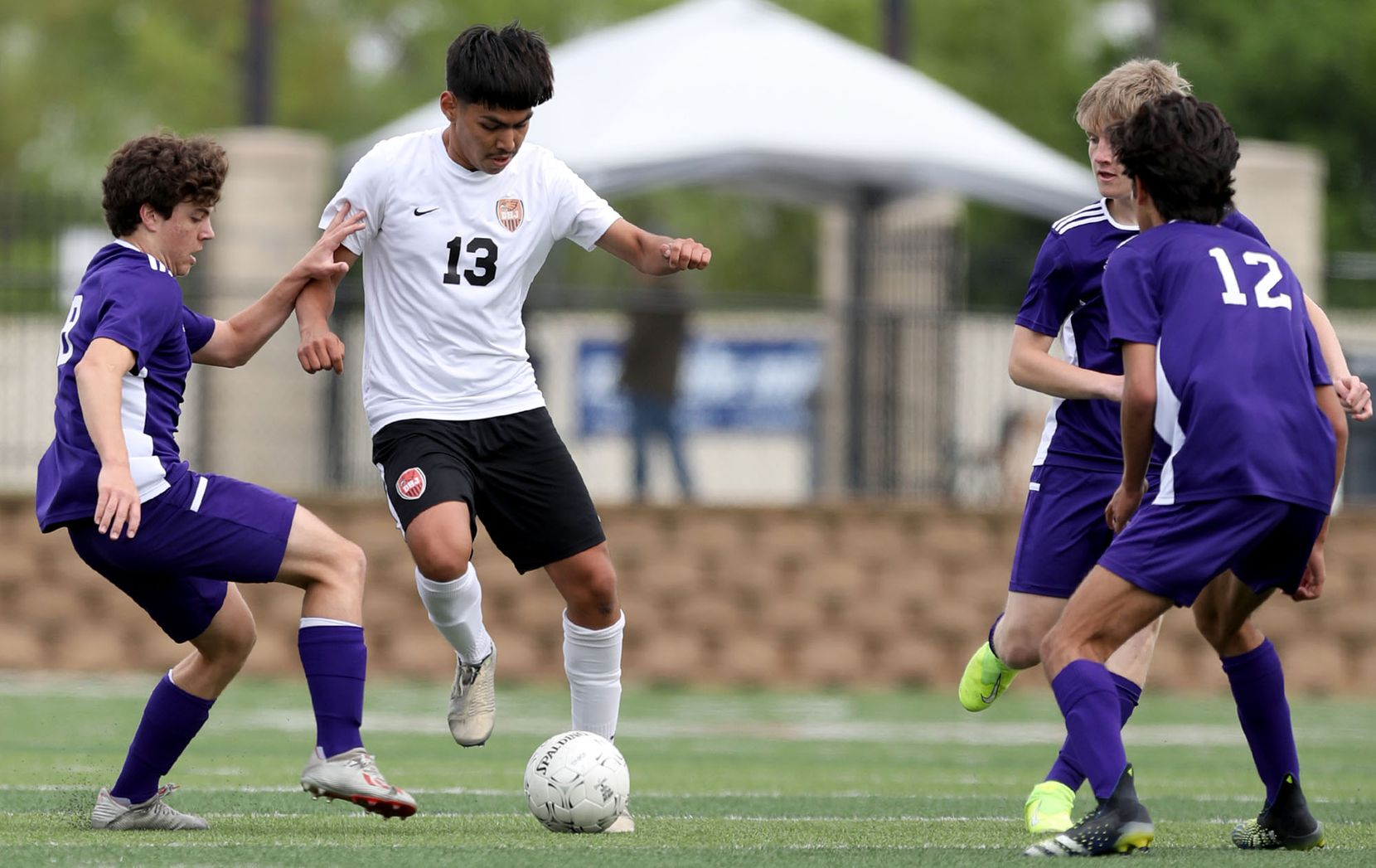 Fort Worth Diamond Hill-Jarvis' Edward Zuniga (13) looks for room around Boerne's Brett Hettie (18), Gustav Erfurt (6), and Juan Castro (12) during their UIL 4A boys State championship soccer game at Birkelbach Field on April 17, 2021 in Georgetown, Texas. (Thao Nguyen/Special Contributor)