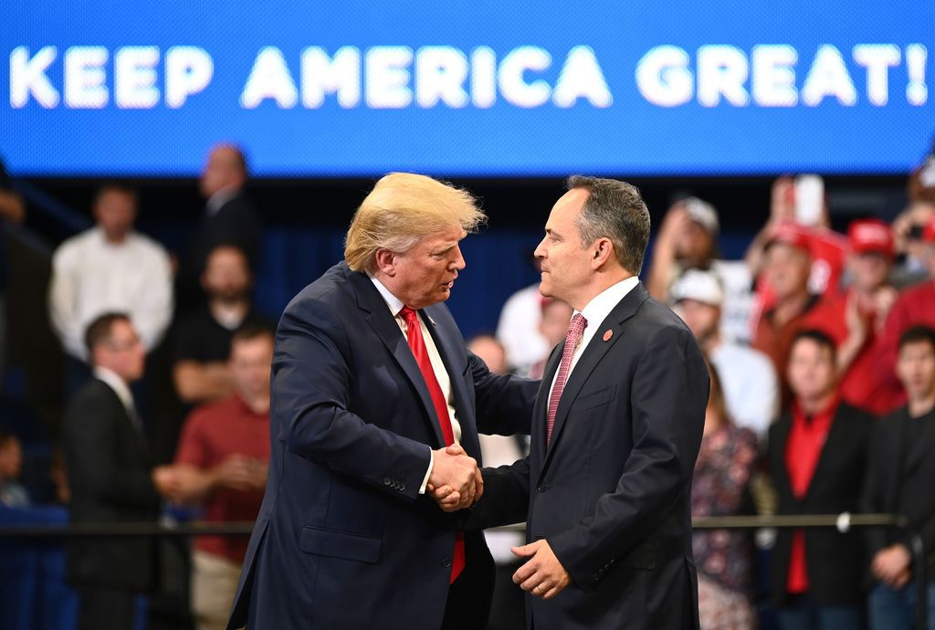 President Donald Trump shakes hands with Kentucky Gov. Matt Bevin during a rally Nov. 5, 20190, in Lexington, Ky. Democrats celebrated big election wins there and in Virginia, states seen as a test of Trump's strength ahead of the 2020 elections, while Republicans held onto a governorship in traditionally conservative Mississippi.