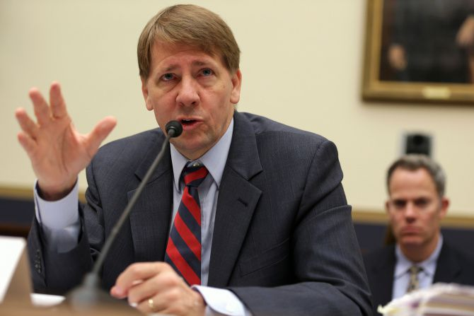 Director of Consumer Financial Protection Bureau Richard Cordray testifies during a hearing before the House Financial Services Committee September 12, 2013 on Capitol Hill in Washington, DC.