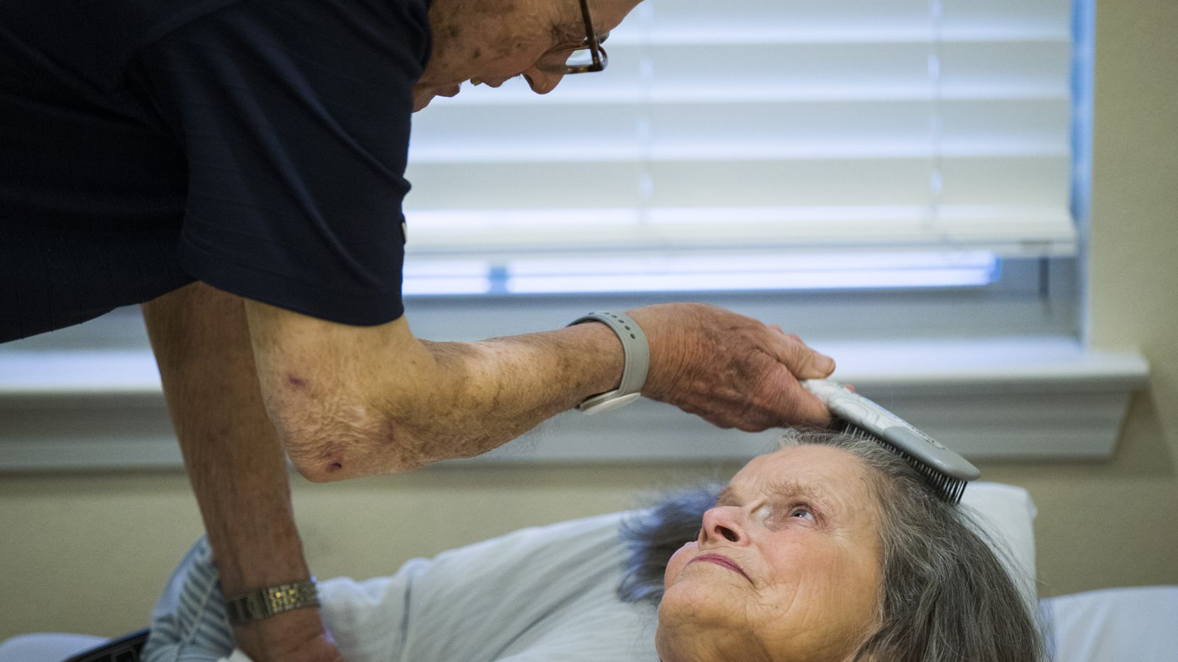 Bob Stiegler, 88, brushes his wife Norma's hair on Wednesday, Sept. 5, 2018 at Silverado Plano Memory Care Community. He lives nearby at The Village at Mapleshade and visits his wife of 58 years, who has Alzheimer's, every night.