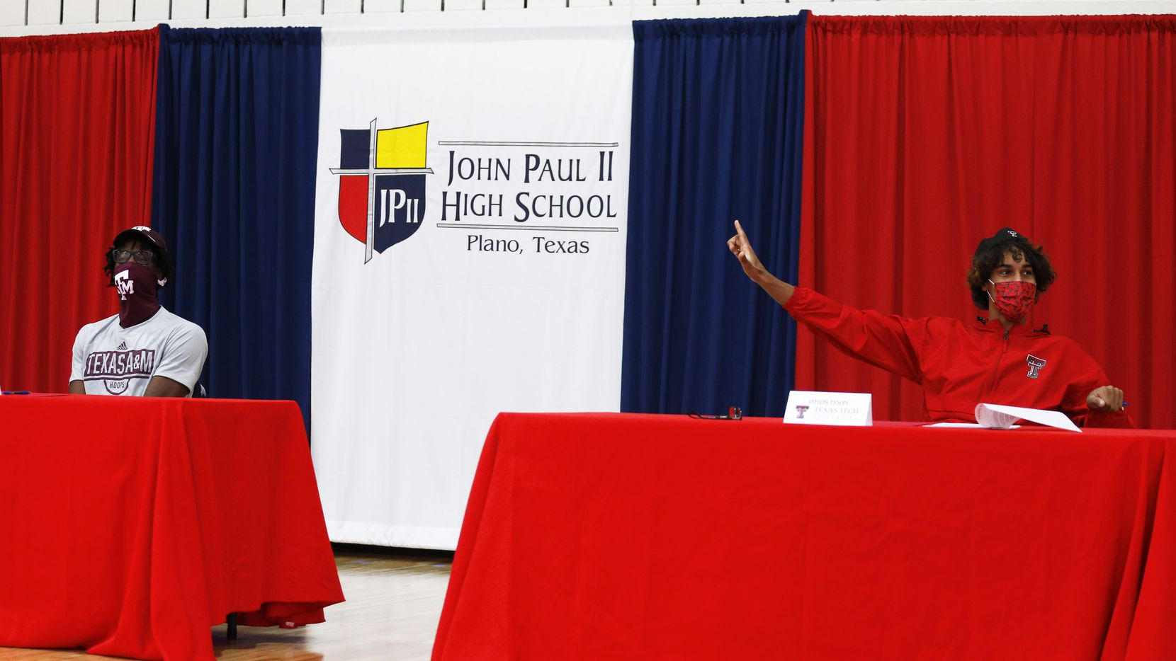 Plano John Paul II basketball players Manny Obaseki (left) and Jaylon Tyson are introduced before signing their national letters of intent on National Signing Day on Wednesday. Obaseki signed with Texas A&M, and Tyson signed with Texas Tech. (Vernon Bryant/The Dallas Morning News)