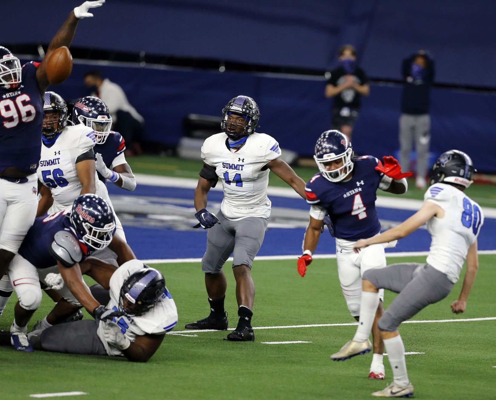 Mansfield Summit kicker Keaton Foster (80) tries to kick an extra point, but it is blocked by Denton Ryan during the first half of the Class 5A Division I state semifinal football playoff game at AT&T Stadium in Arlington on Friday, January 8, 2021. (John F. Rhodes / Special Contributor)