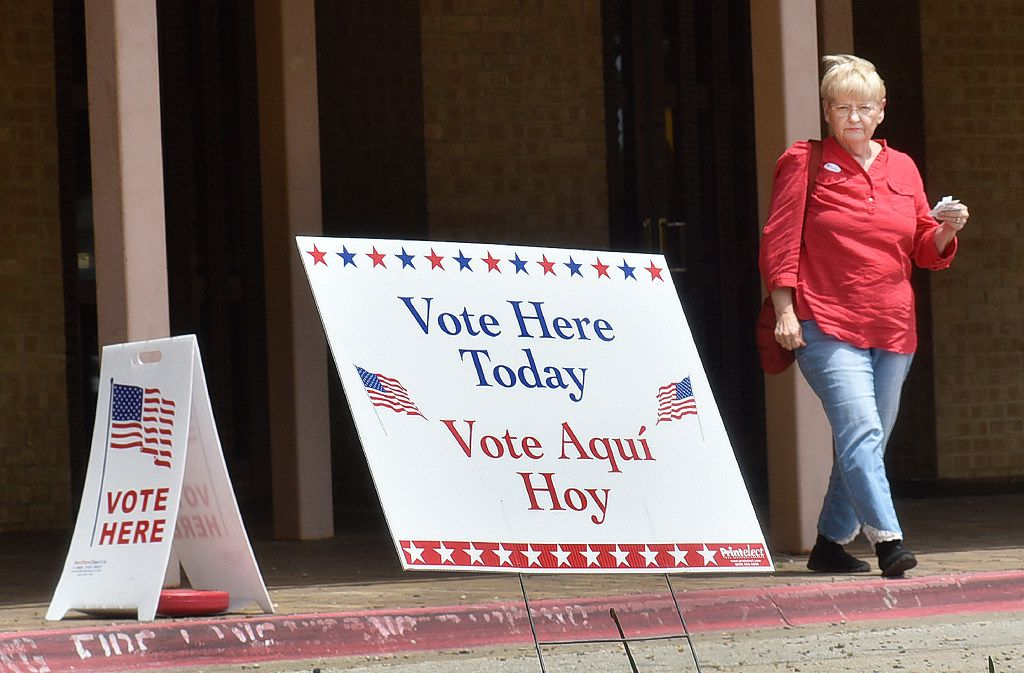 Peggy Capps walks out of the Denton Civic Center after casting her ballot Monday on the first day of early voting for city and school elections. Early voting continues through May 2 ahead of the May 6 election. For a list of early voting sites, see Page 2A. For the DRC/Barron Ludlum