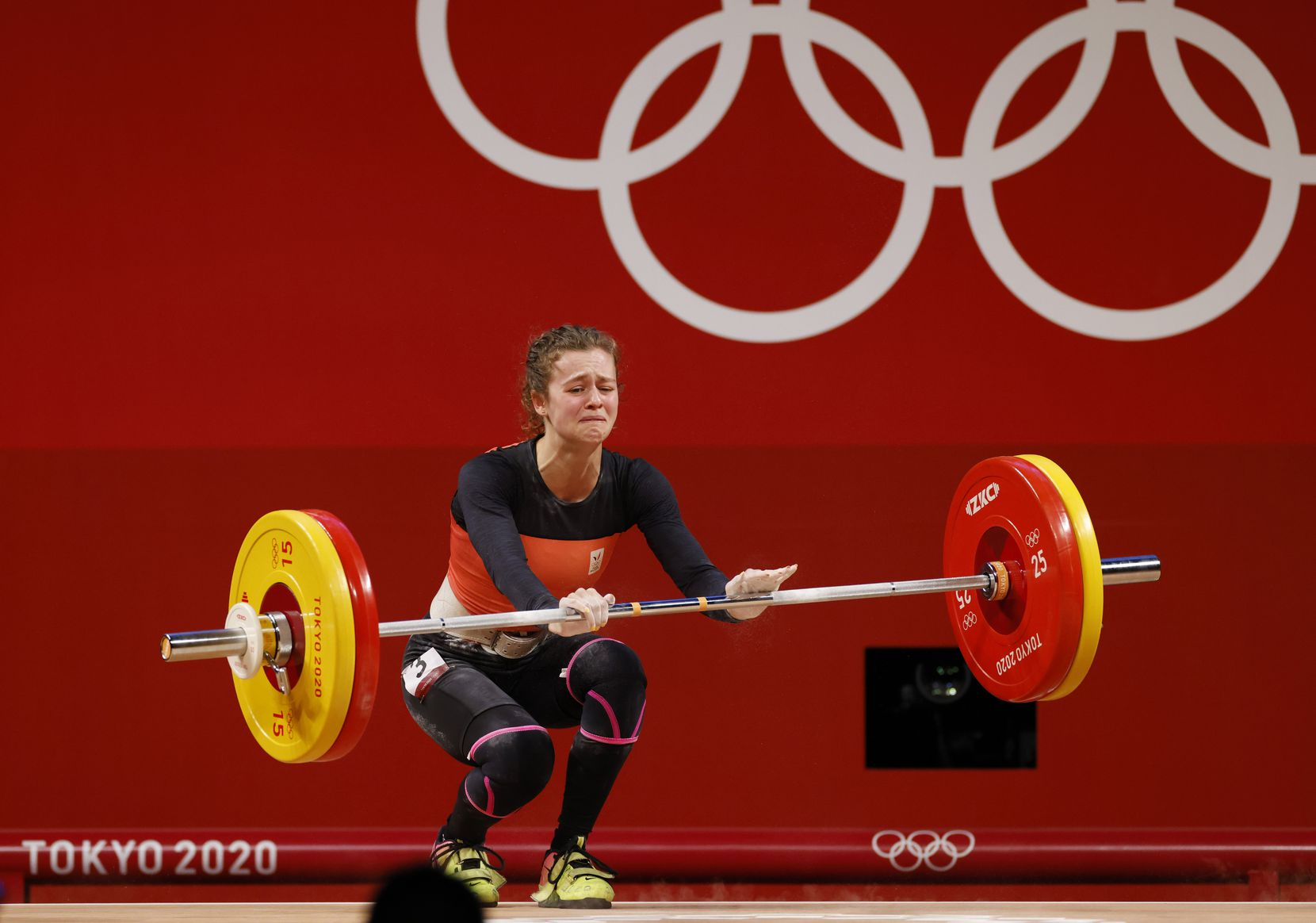 Belgium's Nina Sterckx dejected after an unsuccessful third attempt in the clean and jerk round of 101kg during the women's 49 kg group A weightlifting during the postponed 2020 Tokyo Olympics at Tokyo International Forum on Saturday, July 24, 2021, in Tokyo, Japan. (Vernon Bryant/The Dallas Morning News)