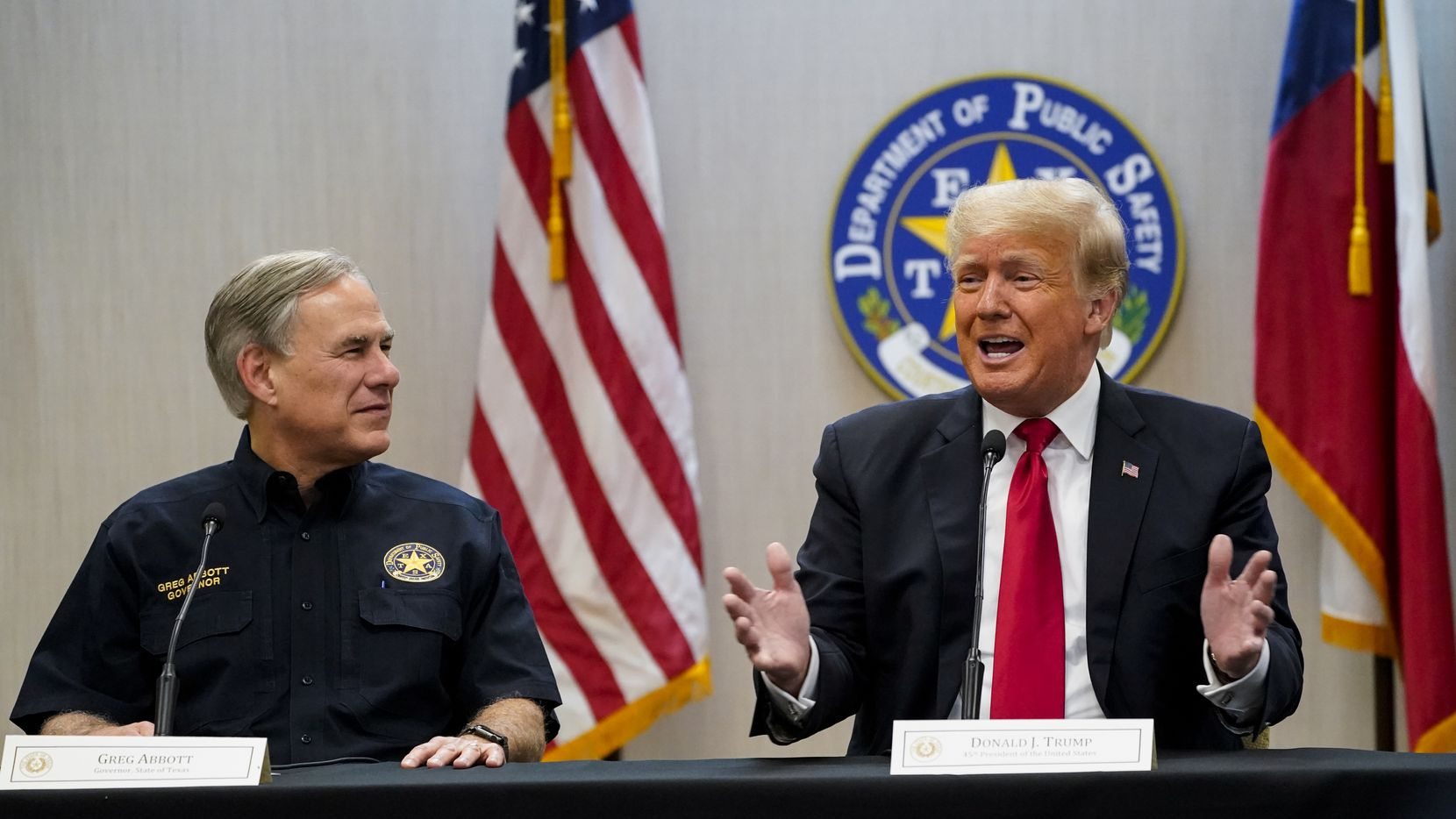 Texas Gov. Greg Abbott and former President Donald Trump attend a briefing on border security with state officials and law enforcement at the Weslaco Department of Public Safety DPS Headquarters before touring the US-Mexico border wall on June 30, 2021.  Trump was invited to South Texas by  Abbott, who has taken up his immigration mantle by vowing to continue building the border wall.