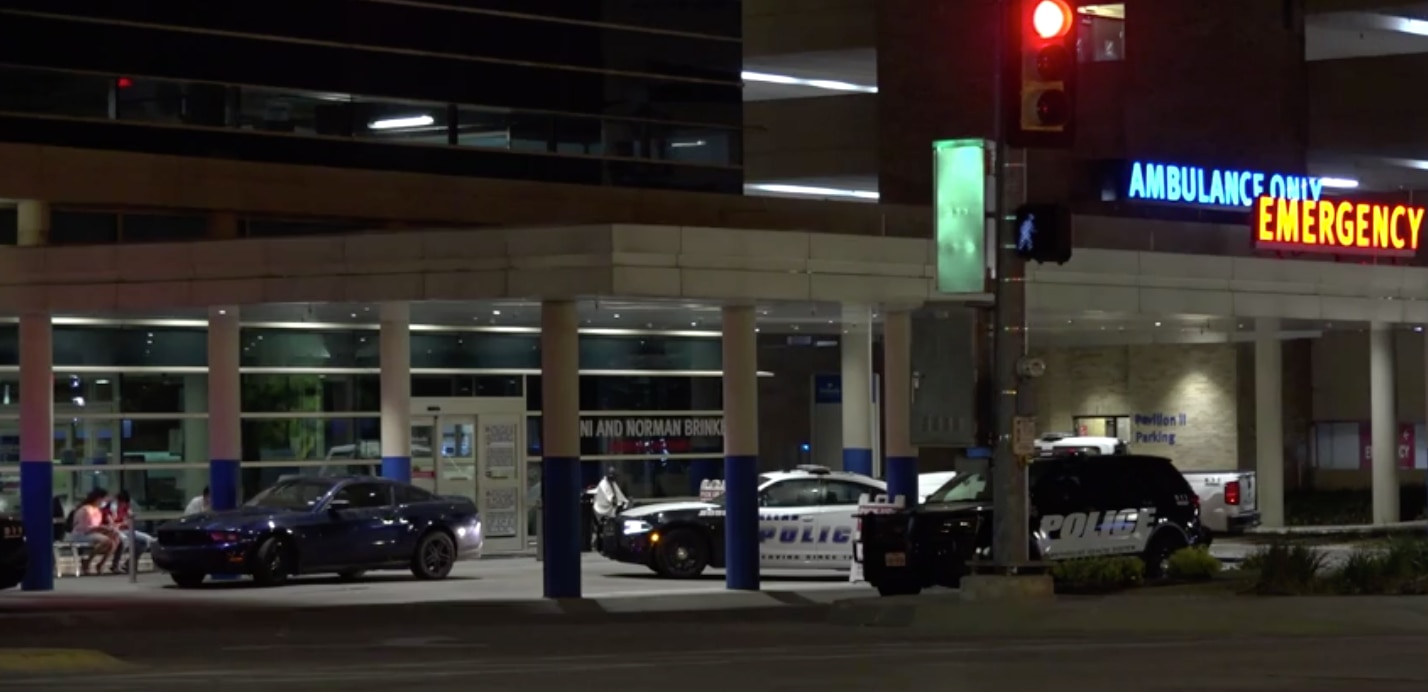 Police at the emergency entrance of Methodist Dallas Medical Center in north Oak Cliff. A shooting victim was taken there Saturday night, where he died.