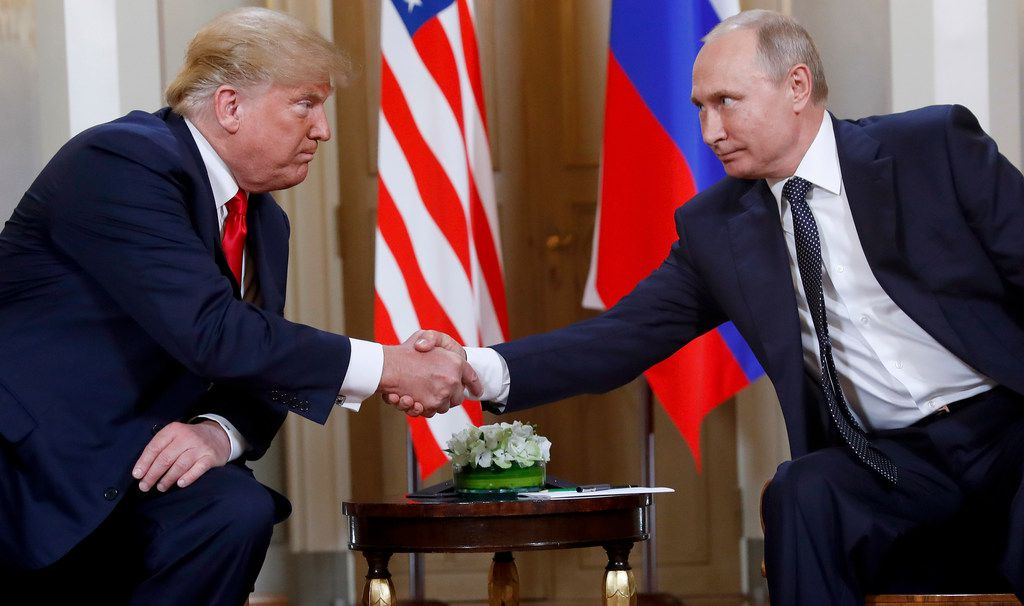 U.S. President Donald Trump and Russian President Vladimir Putin shake hands at the beginning of a meeting at the Presidential Palace in Helsinki, Finland, on July 16, 2018. (AP Photo/Pablo Martinez Monsivais)