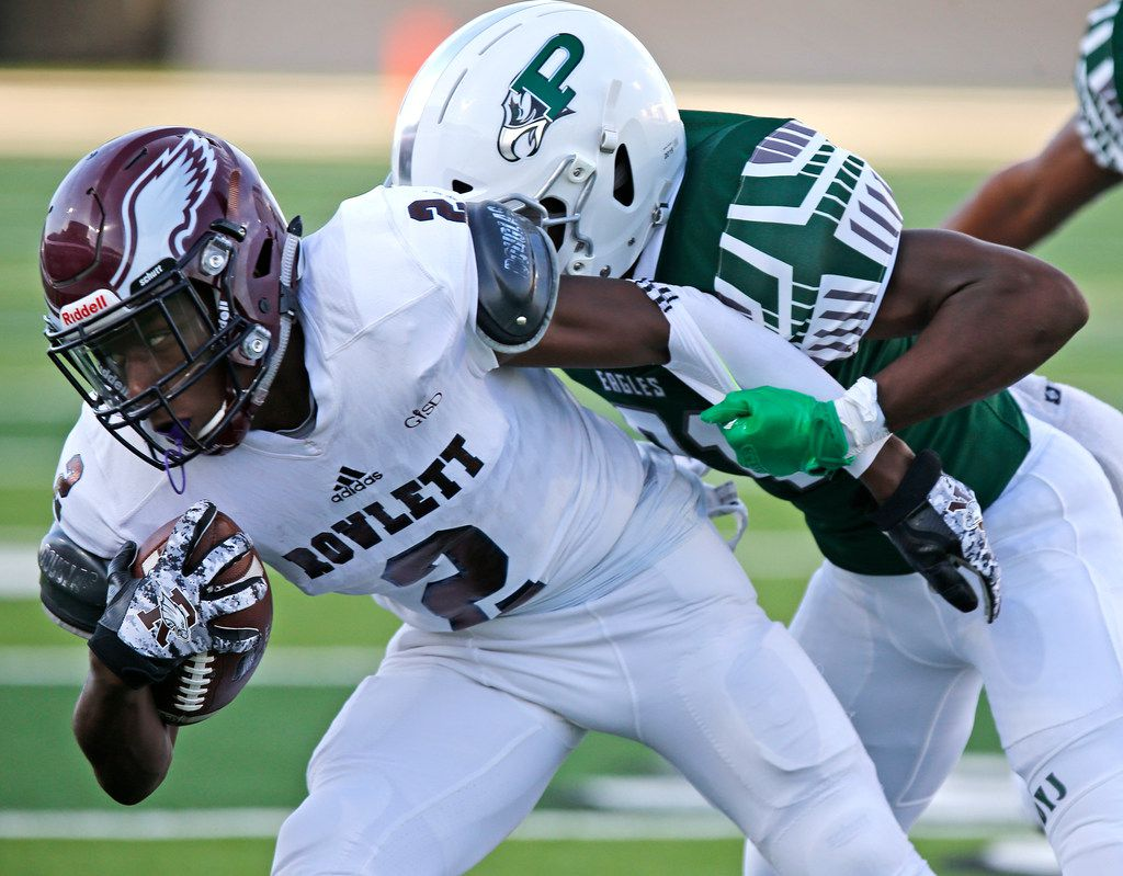 Rowlett High School wide receiver Antonio Hull Jr (2) is tackled by Prosper High School defensive back Jorden Miles (21) during the first half as Prosper High School hosted Rowlett High School in a non-district football game at Children's Health Stadium in Prosper on Friday, August 30, 2019. (Stewart F. House/Special Contributor)