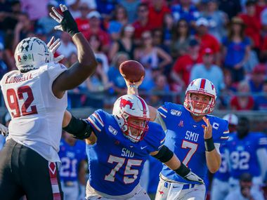 SMU quarterback Shane Buechele (7) gets a block from offensive lineman Hayden Howerton (75) on Temple defensive tackle Karamo Dioubate (92) as he throws a pass during the second half of an NCAA football game at Ford Stadium on Saturday, Oct. 19, 2019, in Dallas. (Smiley N. Pool/The Dallas Morning News)
