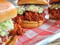 Hattie B's hot chicken sandwich comes with cole slaw, Nashville comeback sauce and a pickle. Customers pick one of six heat levels, from Southern (no heat at all) to Shut The Cluck Up!!! (that one's gonna hurt). The restaurant is expected to open in Deep Ellum in February or March 2022, but its Airstream food truck is coming to Dallas Nov, 5, 6, and 7, 2021.
