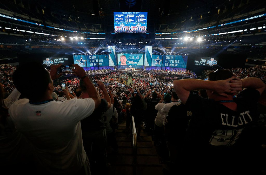 FILE - Fans watch as the Dallas Cowboys select linebacker Leighton Vander Esch from Boise State during the first round of the 2018 NFL draft at AT&T Stadium in Arlington, Texas on Thursday, April 26, 2018. (Rose Baca/The Dallas Morning News)