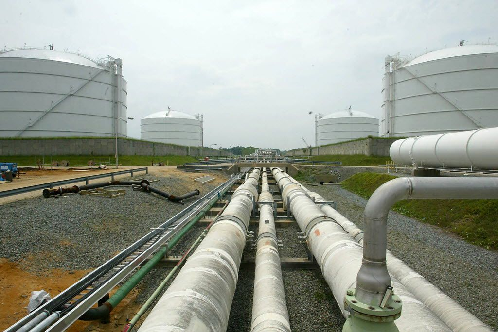 FILE - This June 13, 2003 file photo shows pipelines running from the offshore docking station to four liquefied natural gas (LNG) tanks at the Dominion Resources Inc. Liquified Natural Gas facility in Cove Point, Md. A domestic natural gas boom already has lowered U.S. energy prices while stoking fears of environmental disaster. Now U.S. producers are poised to ship vast quantities of gas overseas as energy companies seek permits for proposed export projects that could set off a renewed frenzy of fracking.