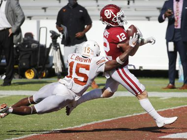 Oklahoma Sooners wide receiver Drake Stoops (12) crosses the goal line for winning touchdown as Texas Longhorns defensive back Chris Brown (15) attempts the tackle in quadruple overtime at the Cotton Bowl in Dallas, Saturday, October 10, 2020. Oklahoma won the Red River Rivalry, 53-45. (Tom Fox/The Dallas Morning News)