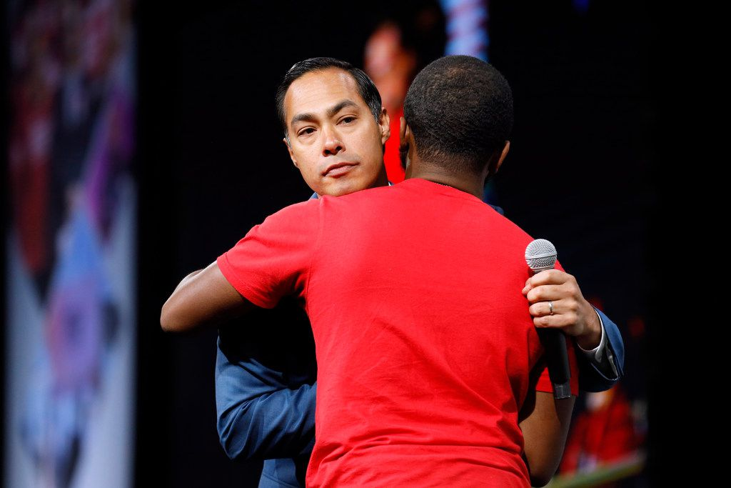 Democratic presidential candidate former U.S. Secretary of Housing and Urban Development Julian Castro gets a hug as he is introduced to speak at the Presidential Gun Sense Forum, Saturday, Aug. 10, 2019, in Des Moines, Iowa. (AP Photo/Charlie Neibergall)