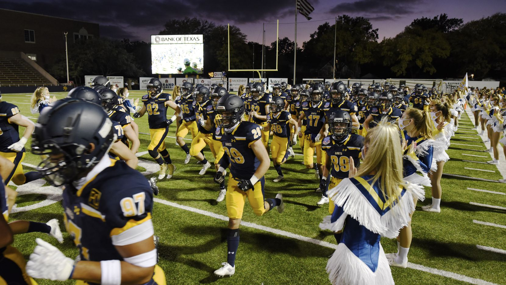 The Highland Park varsity football team runs on to the field for their game versus Coppell High School, on Friday night, Oct. 09, 2020 at Highland Park High School in Dallas.