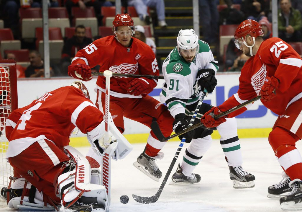 Detroit Red Wings goalie Petr Mrazek (34) stops a Dallas Stars center Tyler Seguin (91) shot as Mike Green (25) defends in the first period of an NHL hockey game Tuesday, Nov. 29, 2016 in Detroit. (AP Photo/Paul Sancya)