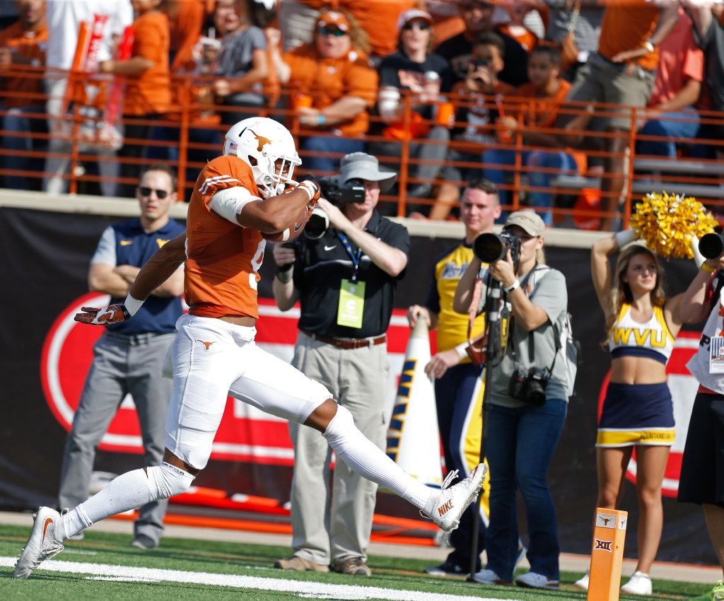 Texas Longhorns wide receiver Collin Johnson (9) runs the ball in for a touchdown against West Virginia Mountaineers in the third quarter at Darrell K RoyalÐTexas Memorial Stadium in Austin Nov. 12, 2016. West Virginia Mountaineers won the game 24-20. (Nathan Hunsinger/The Dallas Morning News)