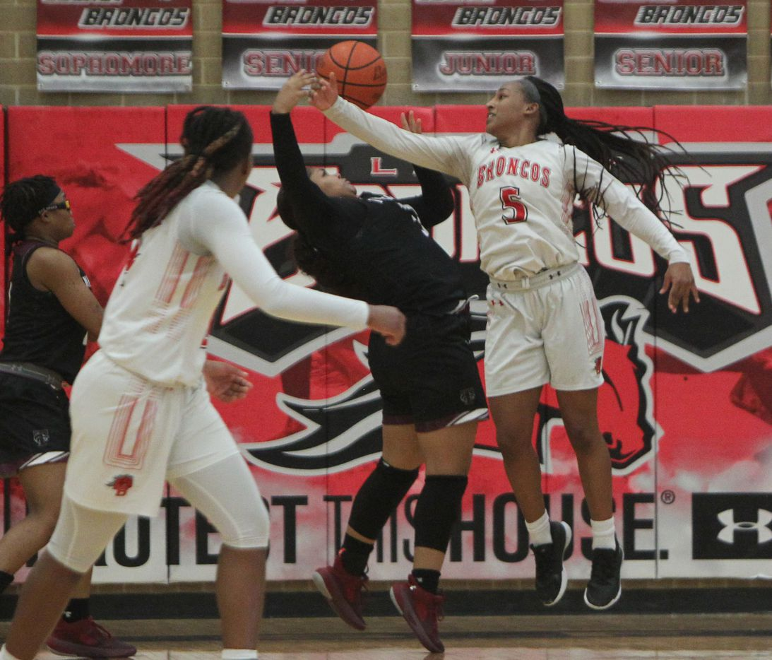 Mansfield Legacy guard Savannah Catalon (5) battles Mansfield Timberview post Trinity King (32) for a rebound during second half action. The two teams played their District 8-5A girls basketball game at Mansfield Legacy High school on January 22 , 2021. (Steve Hamm/ Special Contributor)