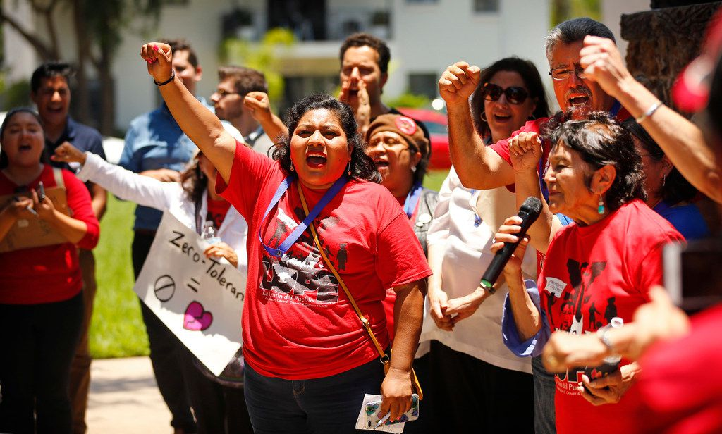 Longtime activist Dolores Huerta (right) leads people assembled for the Break Bread Not Families rally in a chant at Archer Park in McAllen, Texas, Saturday, June 23, 2018. The rally was hosted by LUPE (La Union Del Pueblo Entero) to protest the treatment of families crossing into the United States.
