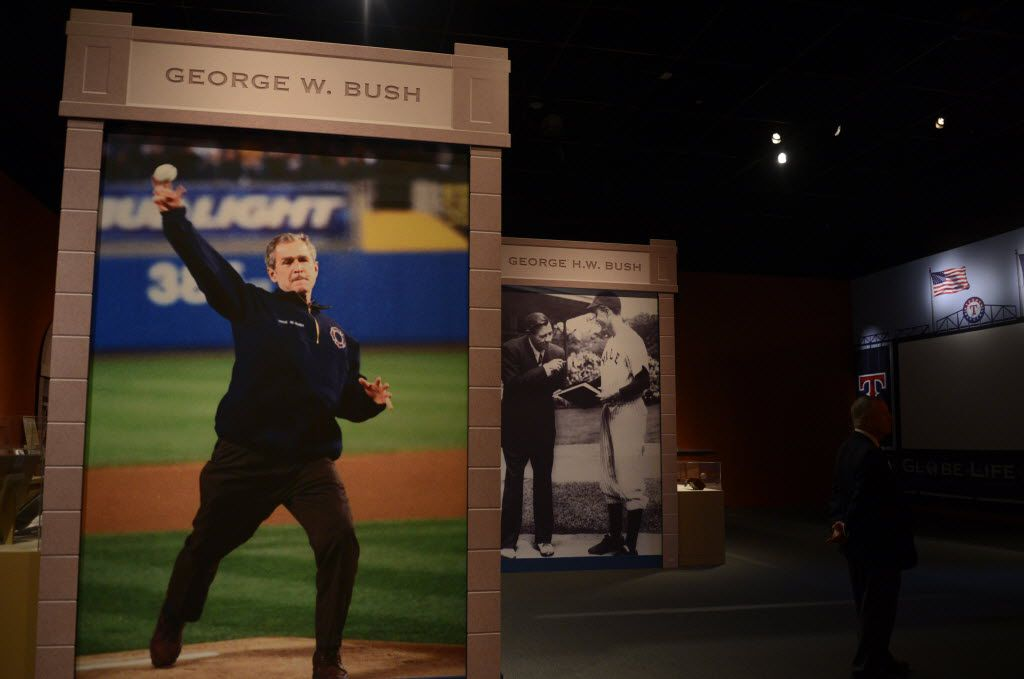 A photograph of President George W. Bush throwing the ceremonial first pitch at Yankee Stadium following 9/11 on display in the Baseball: America's Presidents, America's Pastime exhibit at the George W. Bush Presidential Center in Dallas. (Rose Baca/The Dallas Morning News)