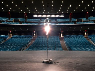 A ghost light illuminates a darkened stage at the empty Music Hall at Fair Park in Dallas, Thursday, Feb. 4, 2021.
