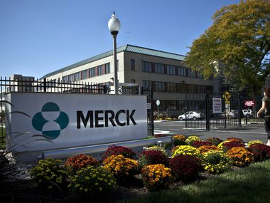 A Merck sign stands in front of the company's building on October 2, 2013 in Summit, New Jersey. (Photo by Kena Betancur/Getty Images)