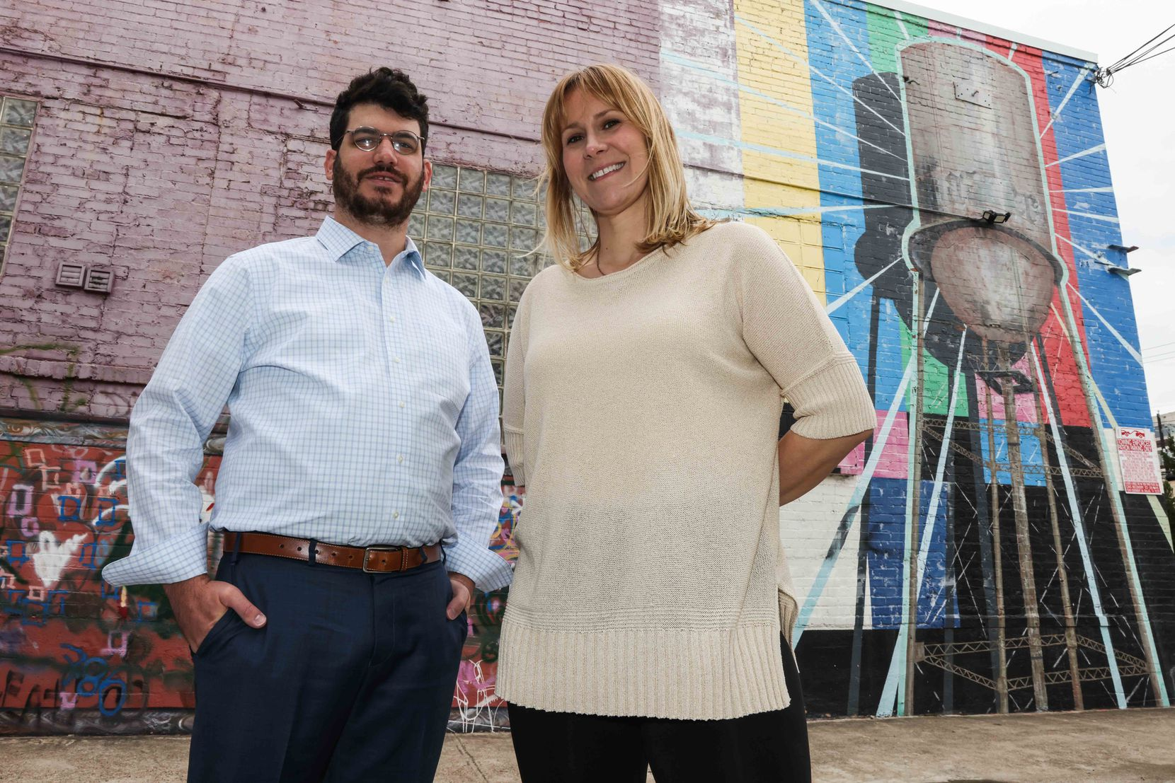 Wil Salisbury and Britt Philyaw from the Heard That Foundation pose together in front of the mural on the corner of Hall and Clover Streets in Deep Ellum.