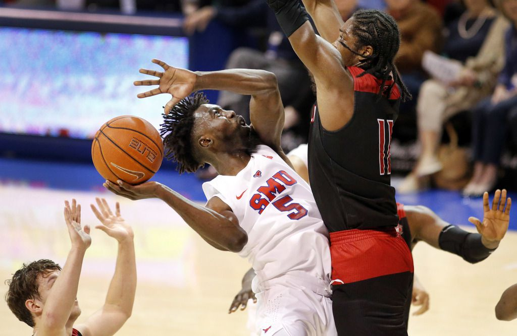 Southern Methodist Mustangs guard Emmanuel Bandoumel (5) puts up a shot against Jacksonville State Gamecocks guard Kayne Henry (11) during the second half at Moody Coliseum  in University Park, Texas, Tuesday, November 5, 2019. SMU won, 74-65. (Tom Fox/The Dallas Morning News)