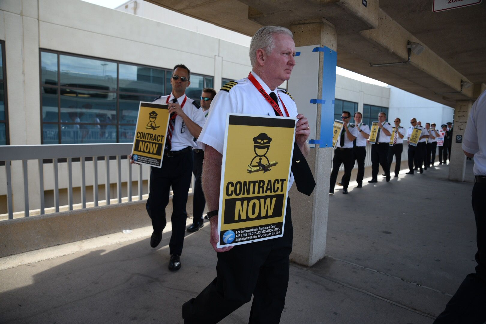 Spirit Airlines pilots and members of the Air Line Pilots Association, International, picket outside DFW Airport's Terminal E on Friday.