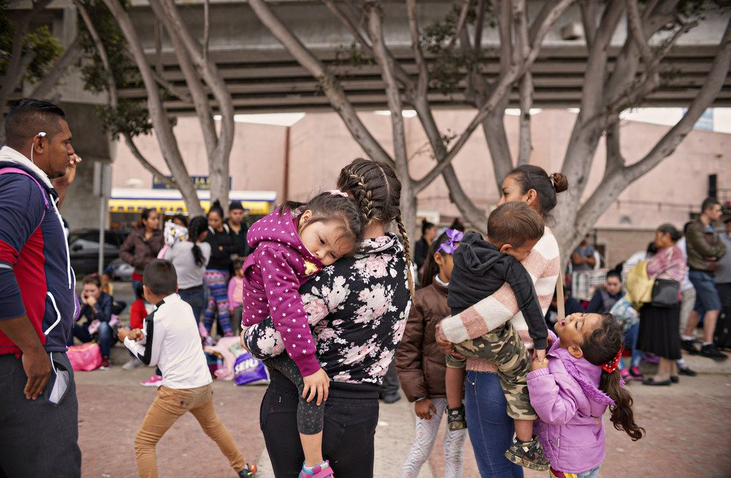 Undocumented migrants wait for asylum hearings outside the U.S. port of entry in Tijuana, Mexico.
