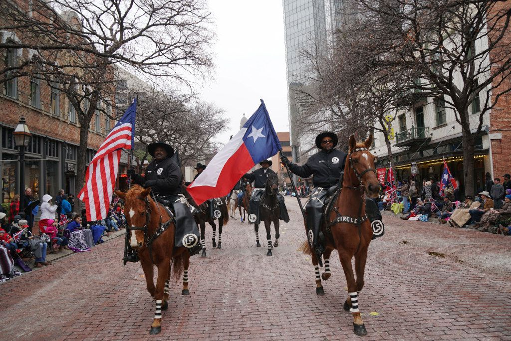 "Circle L5 riding club rode in the Fort Worth Stock Show's ""All Western Parade"" in downtown Fort Worth, Texas on Saturday, January 14, 2017. Everything from covered wagons, high school marching bands, and horse clubs participated.   (Lawrence Jenkins/Special Contributor)"