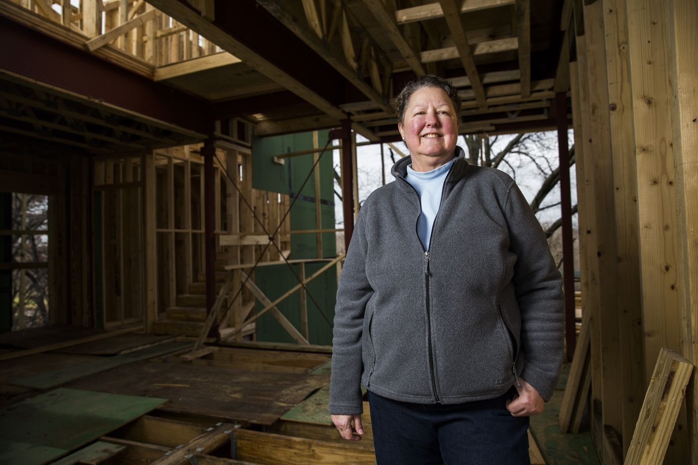 Builder Diane Cheatham poses for a portrait inside a home under construction in her Urban Reserve home development on Vanguard Way  in Dallas.