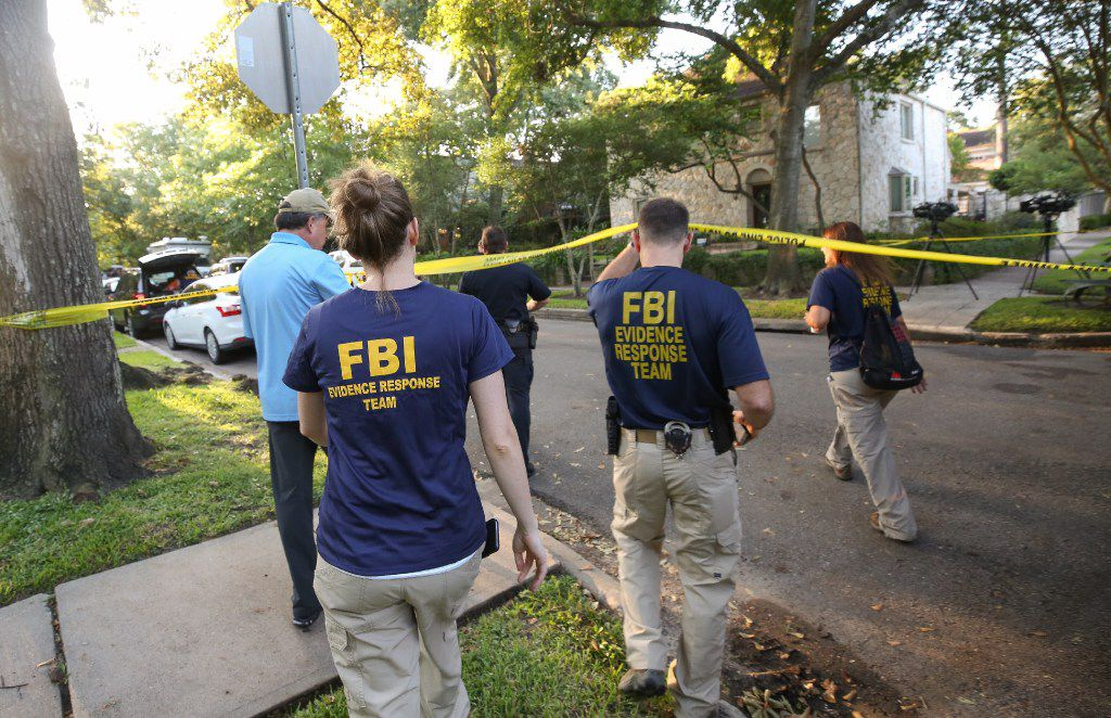 """FBI, Bureau of Alcohol, Tobacco, Firearms and Explosives (ATF), and Houston Police work at the scene of a """"law enforcement operation"""" led by the FBI on the 2000 block of Albans Road Monday, Aug. 21, 2017, in Houston. Andrew Schneck of Houston was arrested Saturday night, Aug. 19, after a Houston park ranger spotted him kneeling in bushes in front of the statue of Confederate officer Richard Dowling in Hermann Park. He has been charged with trying to plant explosives at the statue of Confederate officer Richard Dowling in the park, federal officials said Monday. (Godofredo A. Vasquez/Houston Chronicle via AP)"""