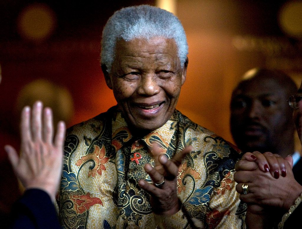 In this Oct. 6, 2007, file photo, former South African President Nelson Mandela reacts after a meeting at the Nelson Mandela Foundation building in Johannesburg, South Africa.