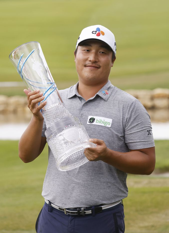 Kyoung-Hoon Lee lifts the trophy after winning the AT&T Byron Nelson at TPC Craig Ranch on Saturday, May 16, 2021 in McKinney, Texas. (Vernon Bryant/The Dallas Morning News)